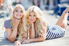 Two blonde near Yacht Club Royalty Free Stock Images