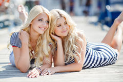 Two blonde near Yacht Club Stock Images