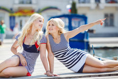 Two blonde near Yacht Club Royalty Free Stock Photo
