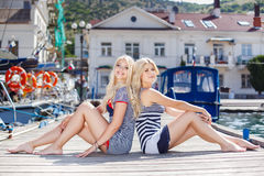 Two blonde near Yacht Club Stock Photography