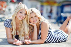 Two blonde near Yacht Club Stock Photos