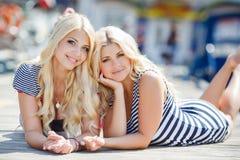 Two blonde near Yacht Club Stock Photos