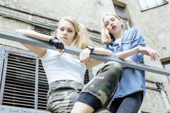 Two blonde real teenage girl hanging out at summer together best friends, lifestyle people concept Royalty Free Stock Photos