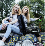 Two blonde real teenage girl hanging out at summer together best friends, lifestyle people concept Stock Photography