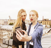 Two blonde real teenage girl hanging out at summer together best friends, lifestyle people concept Stock Images