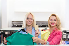 Two Blonde Woman Shopping Buying Fitting Colorful Dress, Happy Smiling Girls Customers Fashion Shop Choosing Clothes Stock Image
