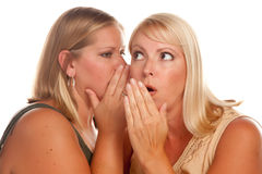 Two Blonde Woman Whispering Secrets Stock Image