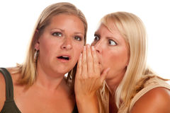 Two Blonde Woman Whispering Secrets Royalty Free Stock Photos