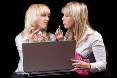 Two blondes do makeup Royalty Free Stock Image