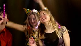 Two blondes in the foreground dancing  a nightclub stock video footage