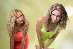 Two blondes on a green background Royalty Free Stock Images