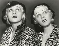 Two blondes in leopard print stock photo