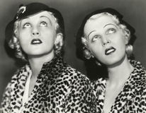 Two blondes in leopard print Stock Images