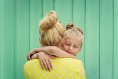 Two blondes Mom and daughter smiling, hugging Stock Image