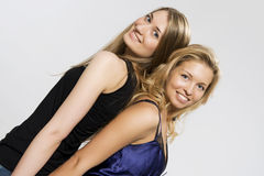 Two blondes of spin to the back. Girls of blonde of girl-friend are in jeans of spin to the back Stock Photo
