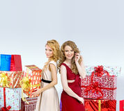 Two blondies holding Christmas presents Royalty Free Stock Photography