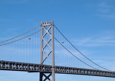Two Blue Angels fly behind the Bay Bridge Royalty Free Stock Image