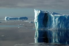 Two blue Antarctic icebergs Stock Photo