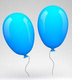 Two blue balloons Stock Images