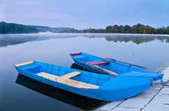 Two blue boats on lake Stock Photo