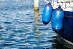 Two blue bumpers. On a sailing boat in a marina Royalty Free Stock Photos