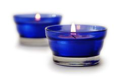 Two blue candles isolated Stock Images