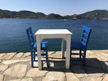 Free Two Blue Chairs And A Table Royalty Free Stock Image - 184171386