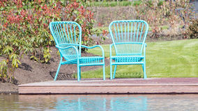 Two blue chairs at the waterfront Stock Photo