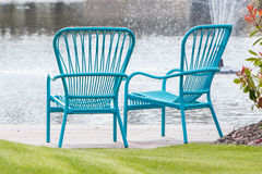 Two blue chairs at the waterfront Royalty Free Stock Photos