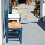 Two blue chairs and white table on the terrace, Santorini Royalty Free Stock Photo