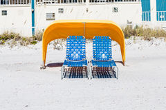 Two Blue Chaise Lounges under Yellow Canopy Royalty Free Stock Photography