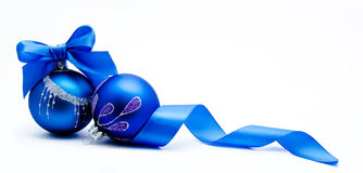 Two blue christmas ball with ribbon isolated Stock Photo