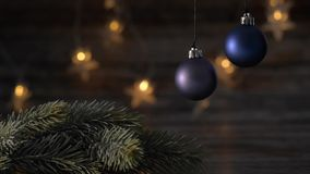 Two blue Christmas ball and spruce branches. Two blue Christmas ball and spruce branches on the background of beautiful bokeh stock video footage
