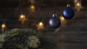 Two blue Christmas ball and spruce branches. Two blue Christmas ball and spruce branches on the background of beautiful bokeh stock video
