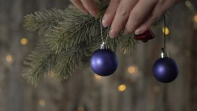 Two blue Christmas ball and spruce branches. Two blue Christmas ball and spruce branches on the background of beautiful bokeh stock footage