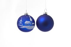 Two blue christmas balls. A two hanging blue christmas balls isolated on white background Stock Image