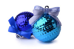 Two blue Christmas balls with ribbon bows. Isolated on white background Royalty Free Stock Image