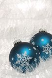 Two blue christmas baubles with snowflakes Royalty Free Stock Photos
