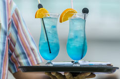 Two blue cocktails. On a tray being served Royalty Free Stock Image