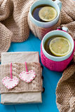 Two blue cup of tea in knitted sweater with hearts felt Stock Photo