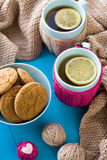 Two blue cup of tea in knitted sweater with hearts felt Royalty Free Stock Photography