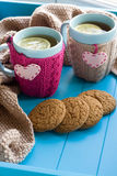 Two blue cup of tea in knitted sweater with hearts felt Royalty Free Stock Images