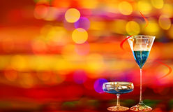 Two blue curacao cocktails and city illumination Royalty Free Stock Image