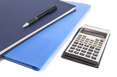 Two blue diary with pen and calculator. Selective focus Stock Images