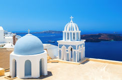 Two blue domes of the beautiful Church of Fira, Santorini in background of Caldera and the sea Stock Image