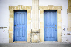 Two blue doors in a southern style building Stock Photos