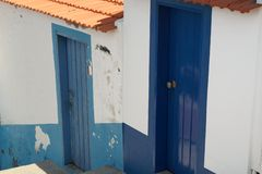Two blue doors on white wall. Funchal on Madeira island, Portugal royalty free stock photo