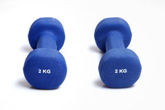 Two blue dumbbells Royalty Free Stock Images