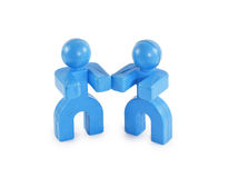 Two blue figures standing near Stock Image