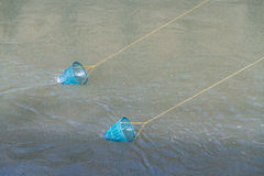 Two blue fishing crab nets on lines Royalty Free Stock Image